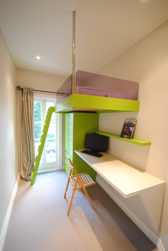 Example of a small trendy gender-neutral kids' room design in London with white walls