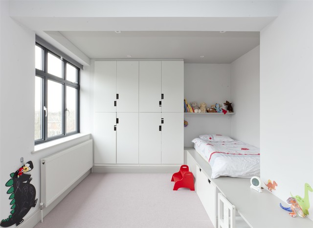 Kids' room - modern gender-neutral gray floor kids' room idea in London with white walls