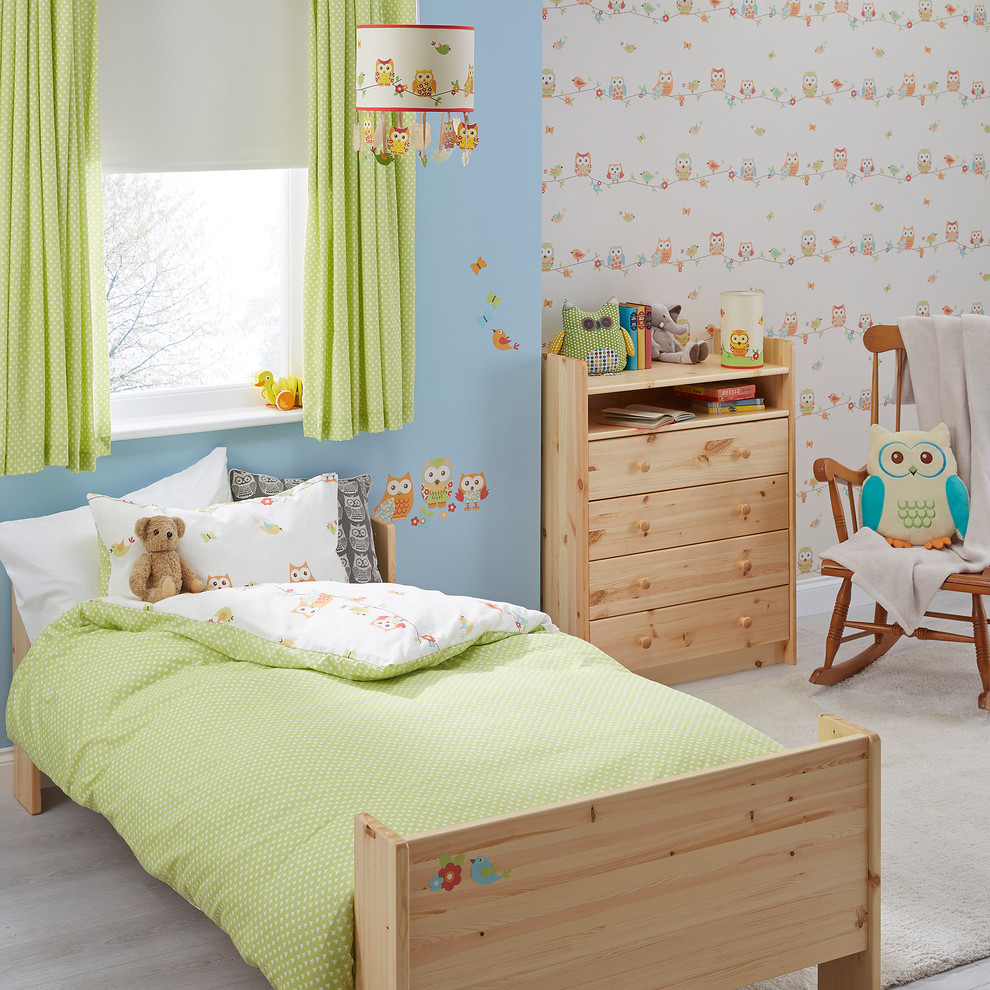 Small trendy gender-neutral light wood floor kids' room photo in Hampshire with blue walls
