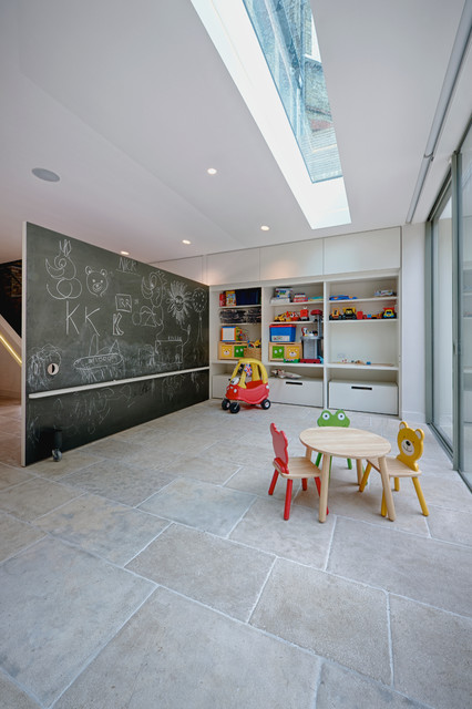 This is an example of a contemporary gender neutral toddler's room in London.