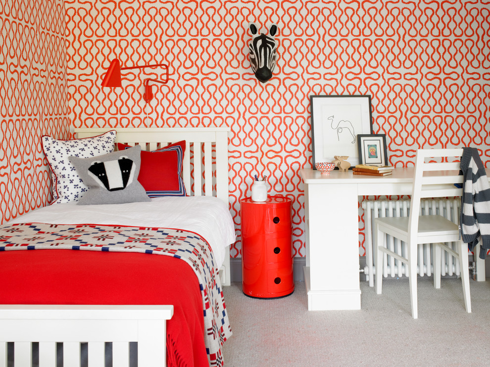 Example of a trendy gender-neutral carpeted and beige floor kids' room design in London with multicolored walls