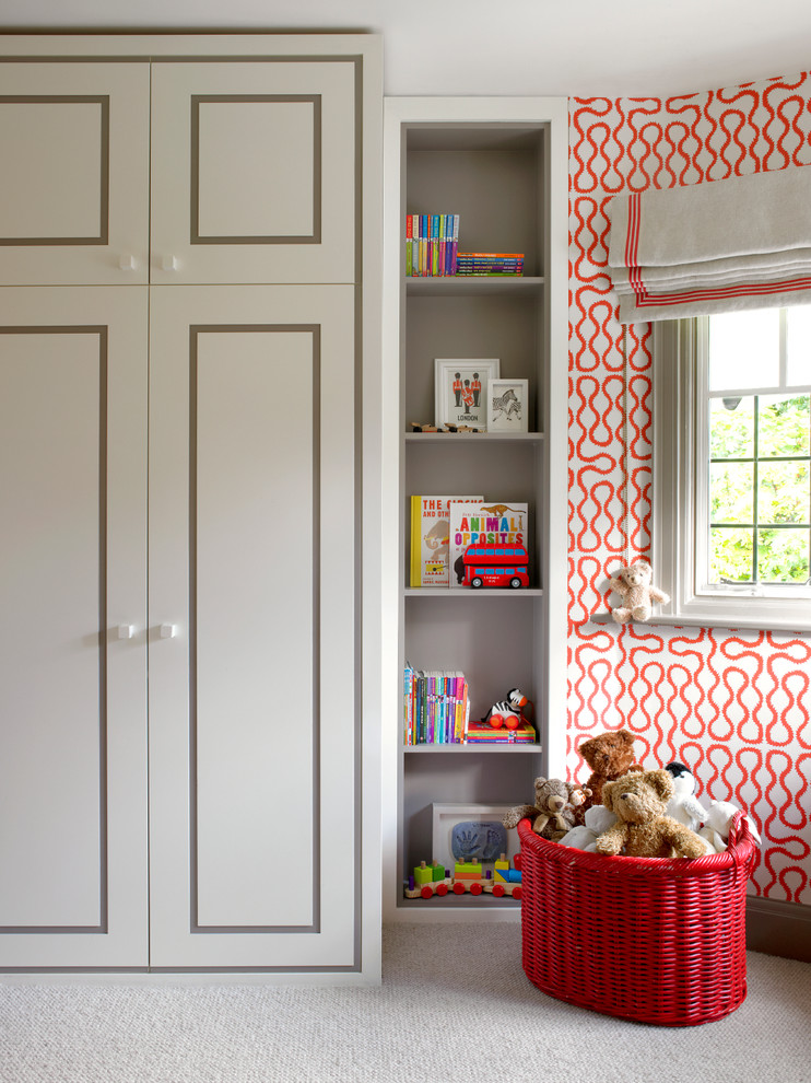 Example of a trendy gender-neutral carpeted kids' room design in London with multicolored walls