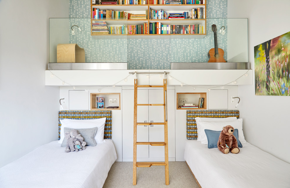Mid-sized mid-century modern gender-neutral carpeted and beige floor kids' room photo in Surrey with white walls
