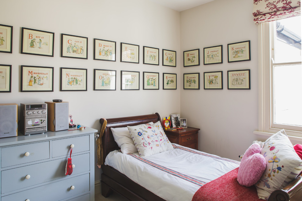 Example of a classic girl kids' room design in Other with white walls