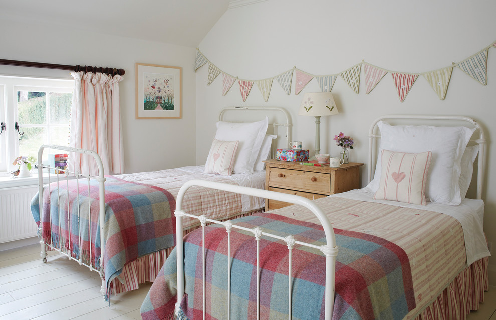 Inspiration for a timeless girl painted wood floor kids' room remodel in Wiltshire with white walls