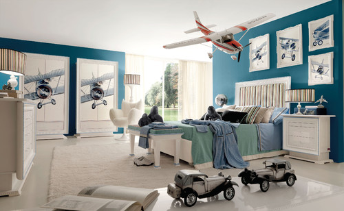 bedroom with airplanes hanging from ceiling