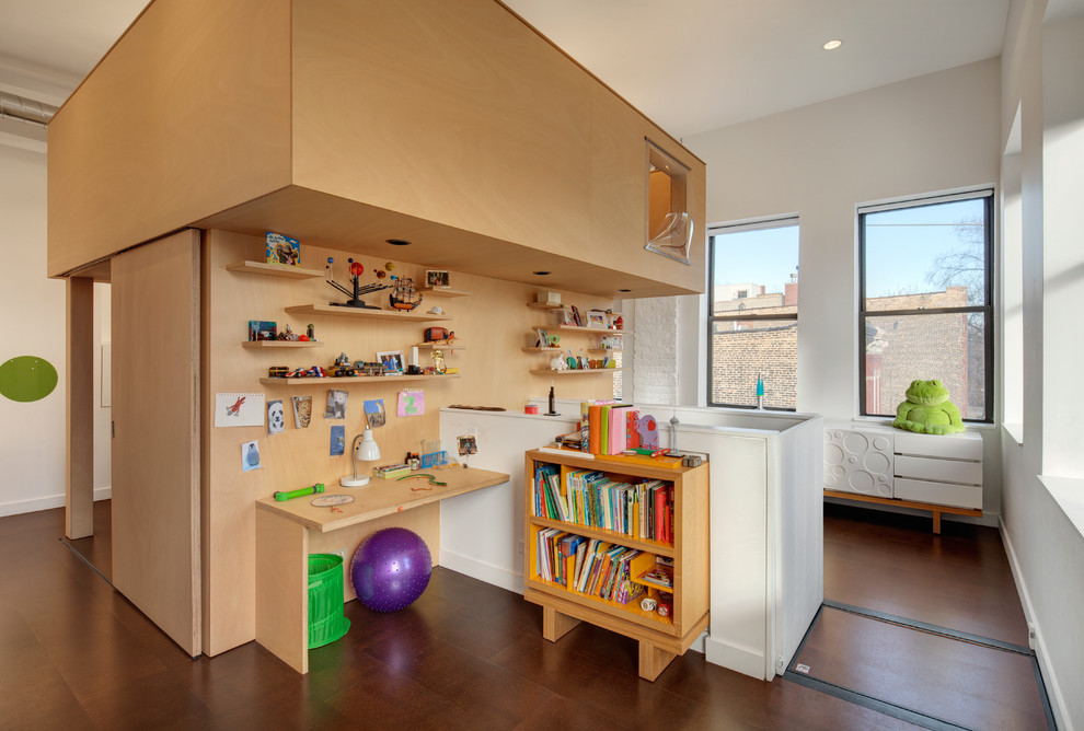 Kids' study room - contemporary gender-neutral kids' study room idea in Chicago with white walls