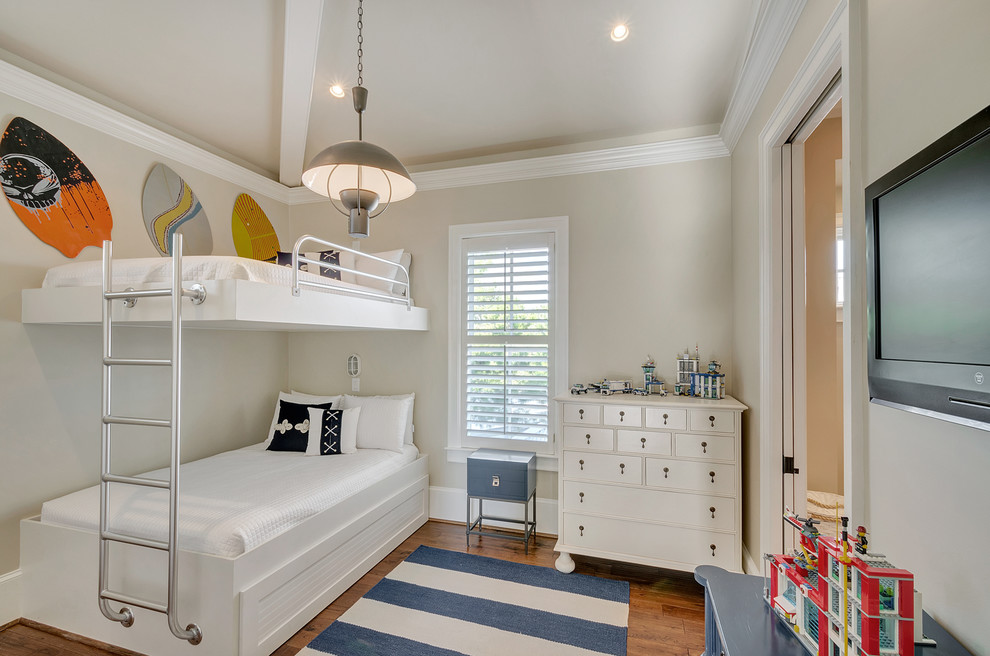 Inspiration for a mid-sized coastal gender-neutral medium tone wood floor kids' room remodel in Miami with beige walls