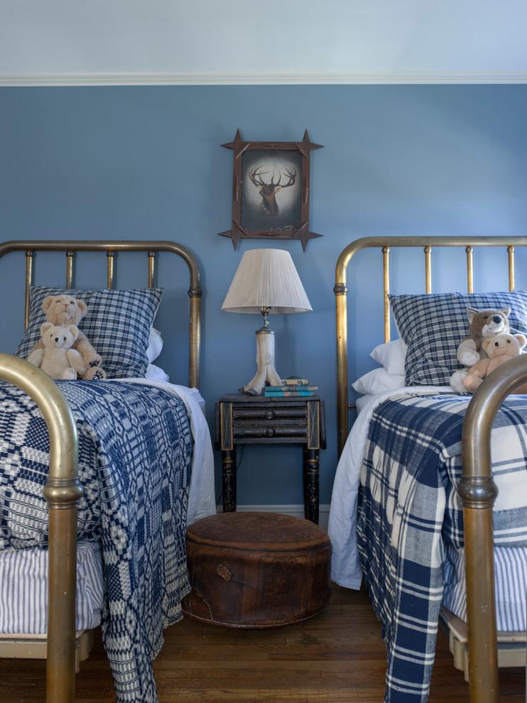 Kids' bedroom - farmhouse boy medium tone wood floor kids' bedroom idea in New York with blue walls