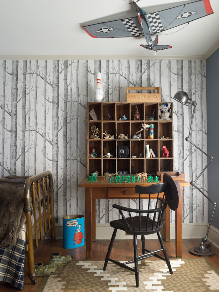 Kids' bedroom - country boy medium tone wood floor kids' bedroom idea in New York with gray walls