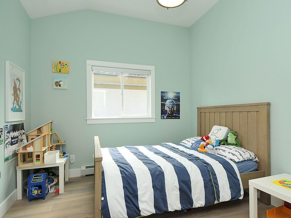 Kids' room - contemporary boy kids' room idea in Vancouver with green walls