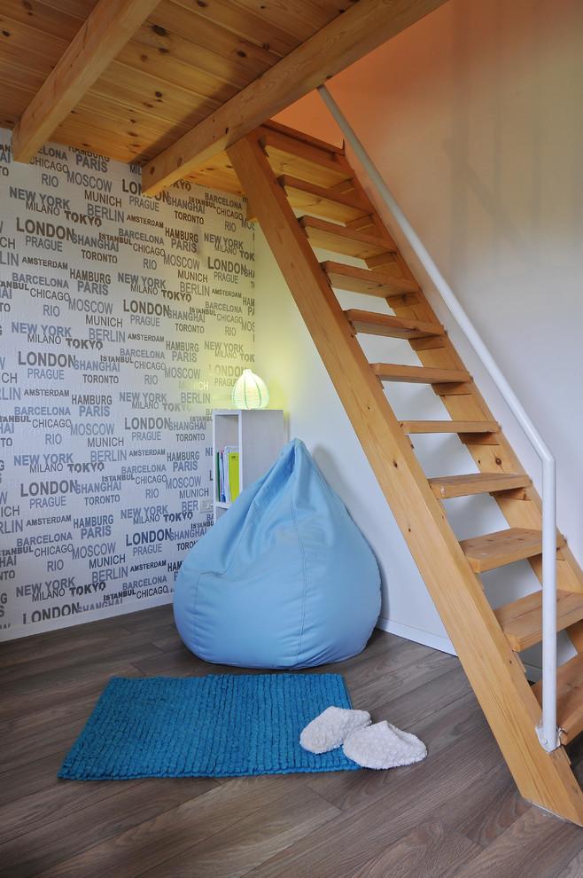 Kids' room - contemporary gender-neutral medium tone wood floor kids' room idea in Tel Aviv with white walls