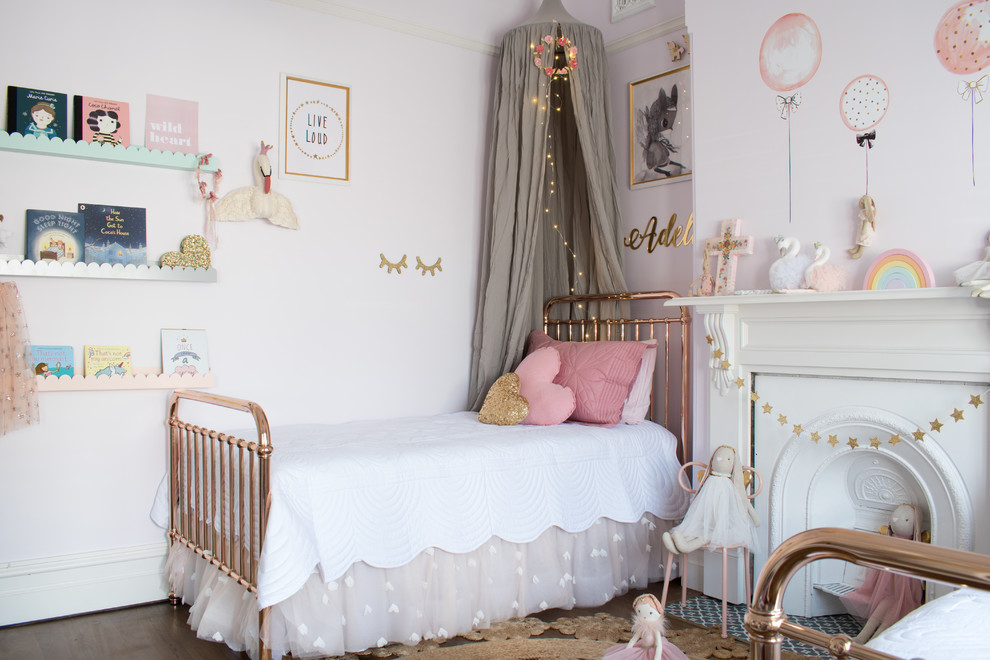 Design ideas for a transitional kids' room for kids 4-10 years old and girls in Sydney with pink walls, dark hardwood floors and brown floor.