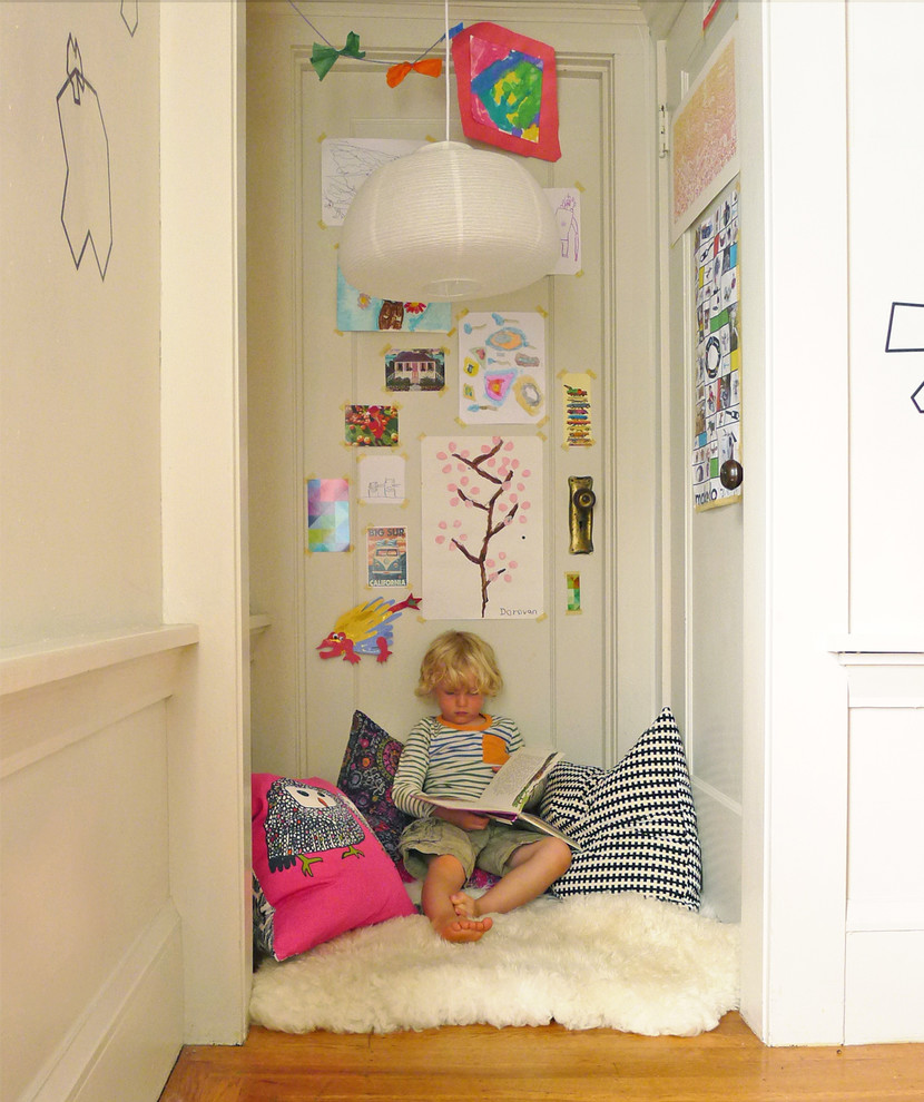 Eclectic gender-neutral medium tone wood floor playroom photo in San Francisco with gray walls