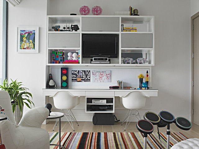 Example of a large trendy gender-neutral medium tone wood floor and beige floor kids' room design in Miami with white walls