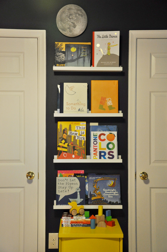 Inspiration for a small classic toddler's room for boys in DC Metro with carpet and black walls.