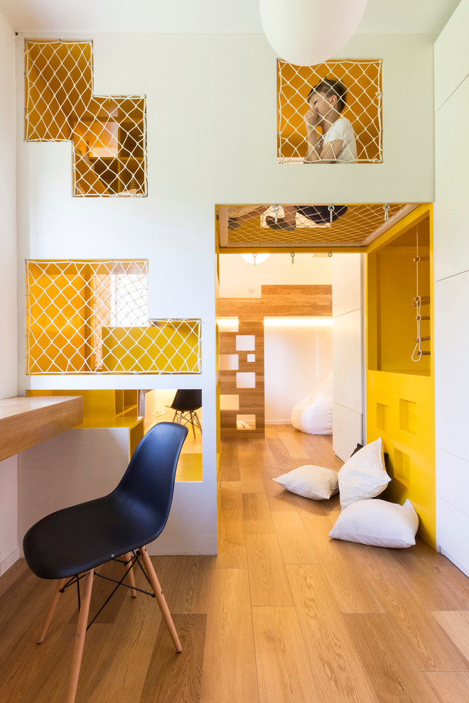 Kids' room - contemporary gender-neutral medium tone wood floor kids' room idea in Moscow with white walls