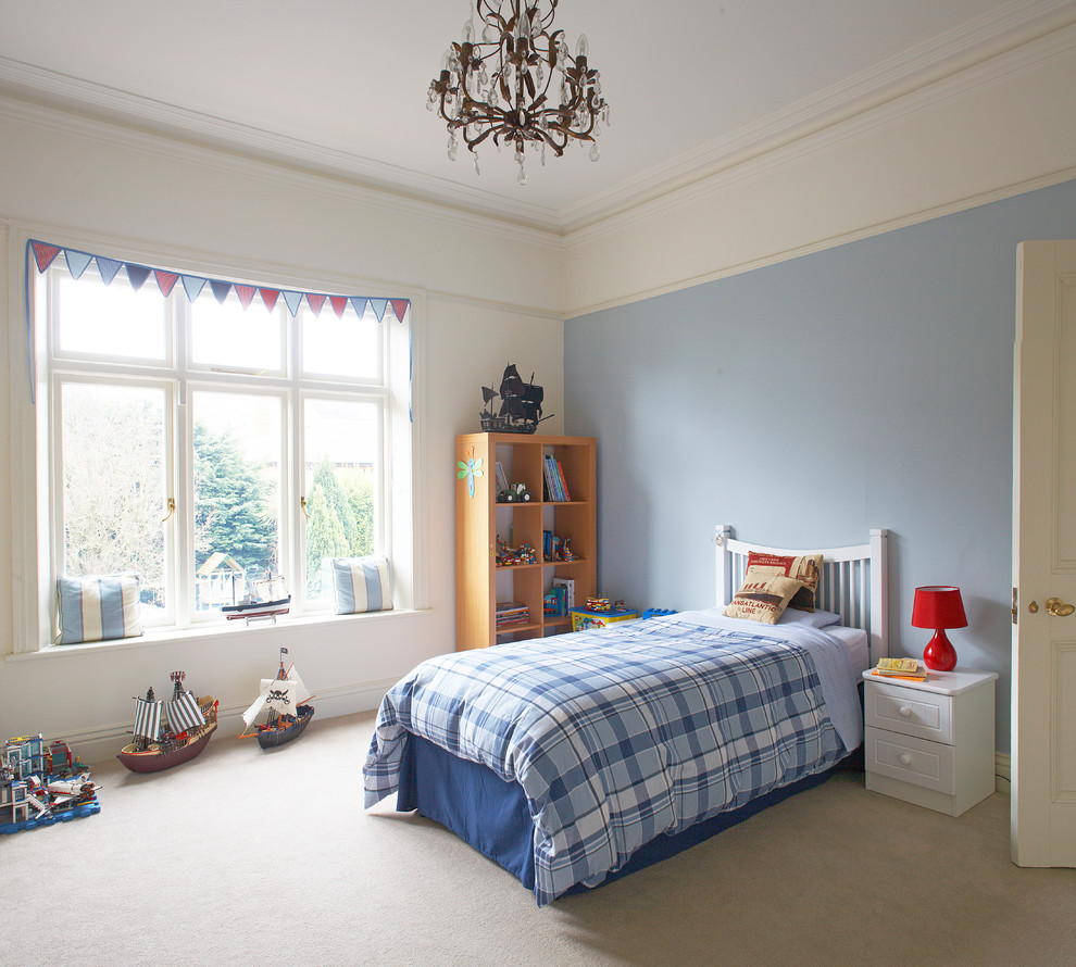 Kids' room - contemporary boy carpeted kids' room idea in Dublin with blue walls