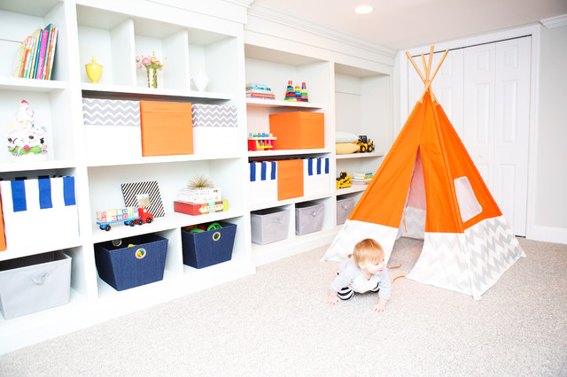 Example of an arts and crafts gender-neutral carpeted kids' room design in Philadelphia with gray walls