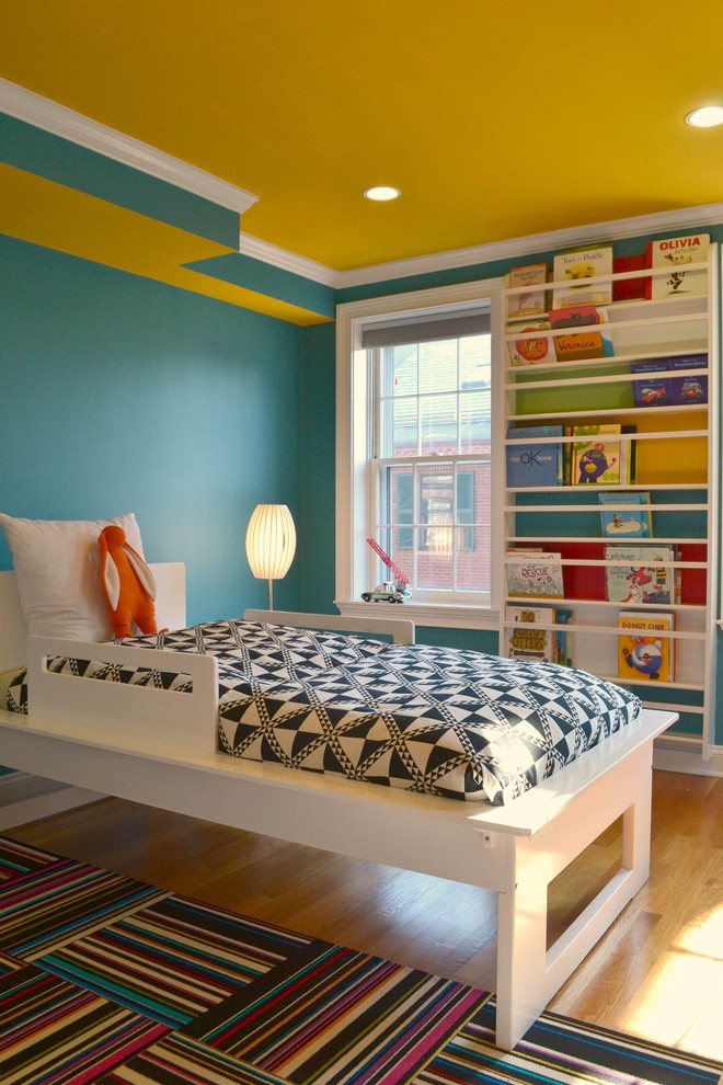 Mid-sized trendy gender-neutral light wood floor kids' room photo in Boston with blue walls