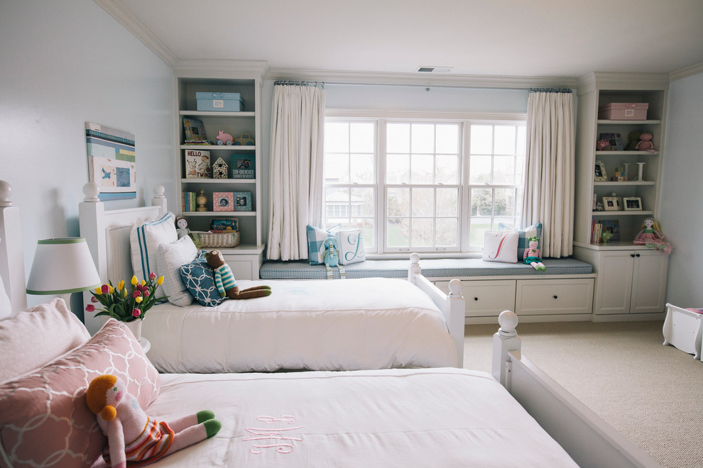 Inspiration for a timeless gender-neutral carpeted kids' bedroom remodel in Chicago with blue walls