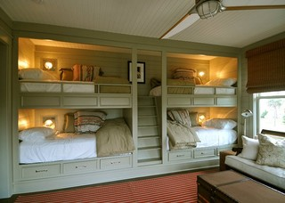 Cool bunk room with lights and storage for each of the 4 beds.