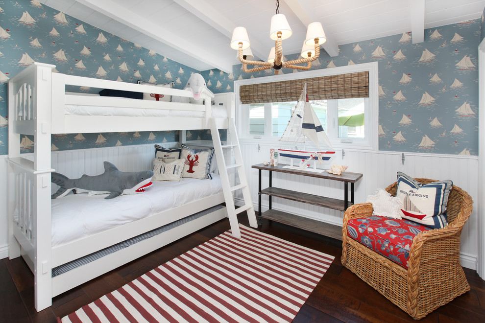 Example of an island style gender-neutral dark wood floor kids' room design in Orange County with multicolored walls