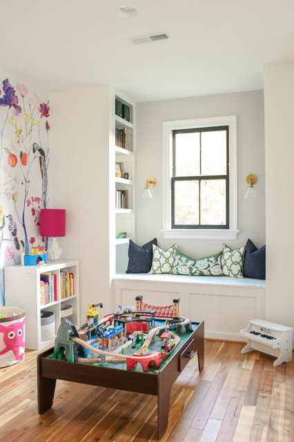 Transitional gender-neutral medium tone wood floor kids' room photo in Richmond with multicolored walls
