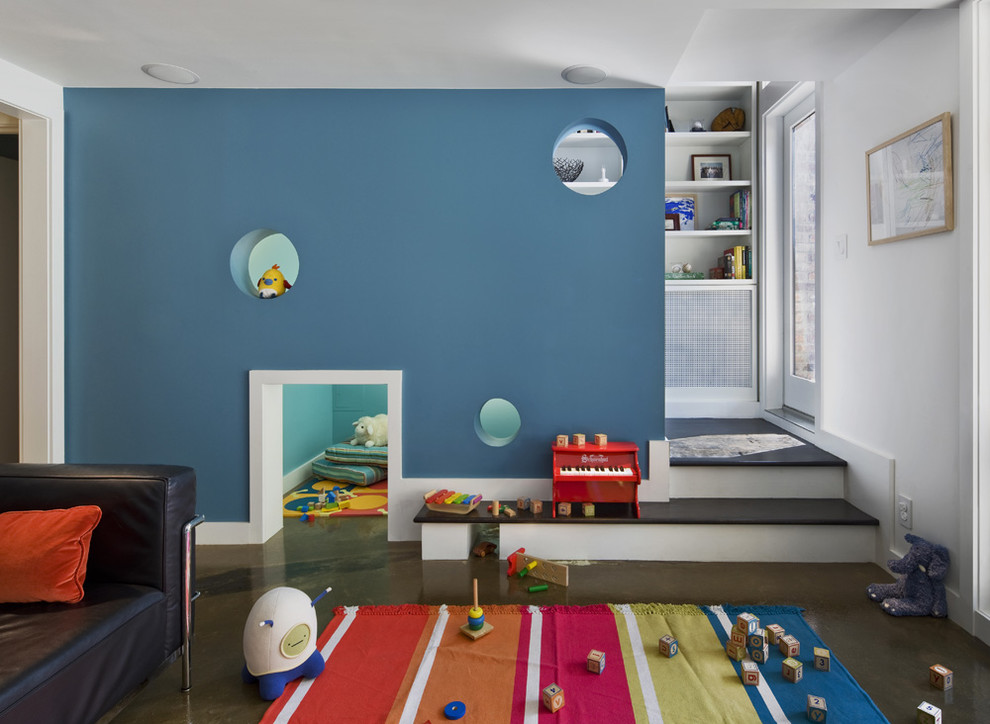 Mid-sized trendy gender-neutral brown floor kids' room photo in New York with blue walls