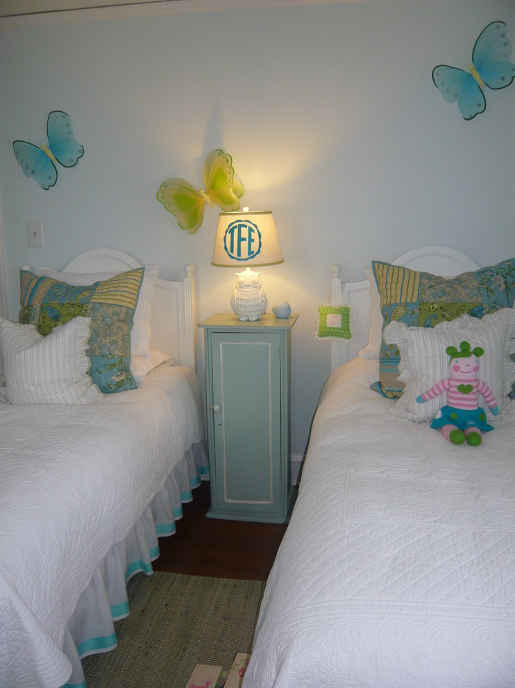 Example of a classic dark wood floor kids' room design in Chicago with blue walls