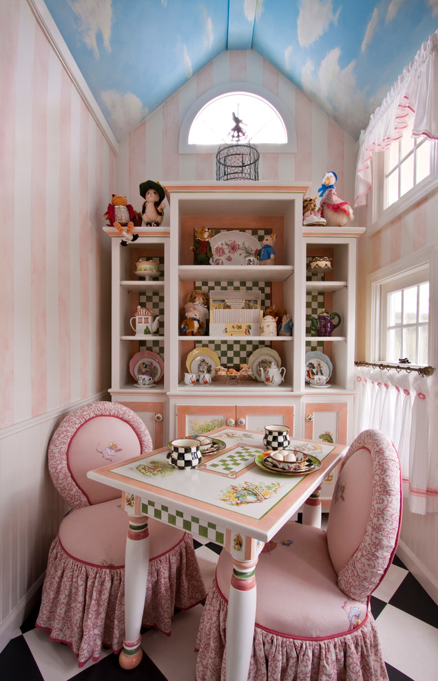 Elegant kids' room photo in Cleveland with multicolored walls