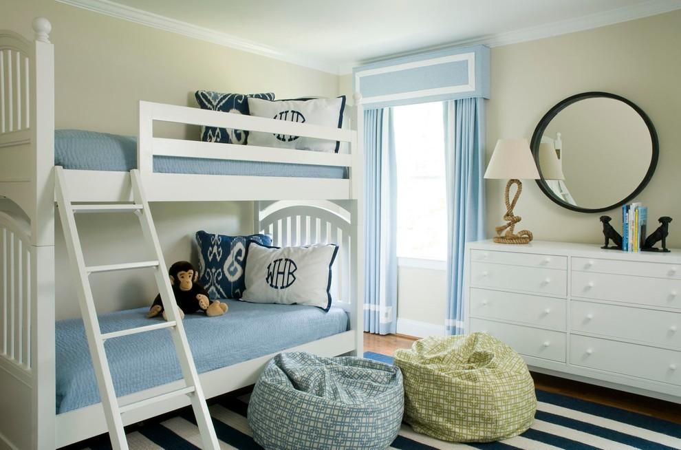 Elegant gender-neutral dark wood floor kids' bedroom photo in Wilmington with beige walls