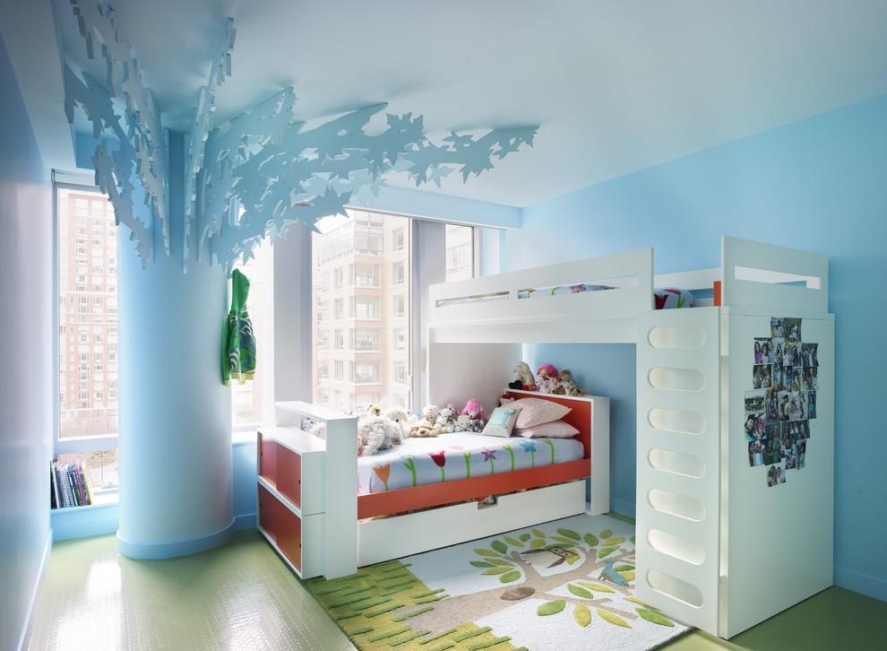 Kids' room - eclectic gender-neutral green floor kids' room idea in New York with blue walls