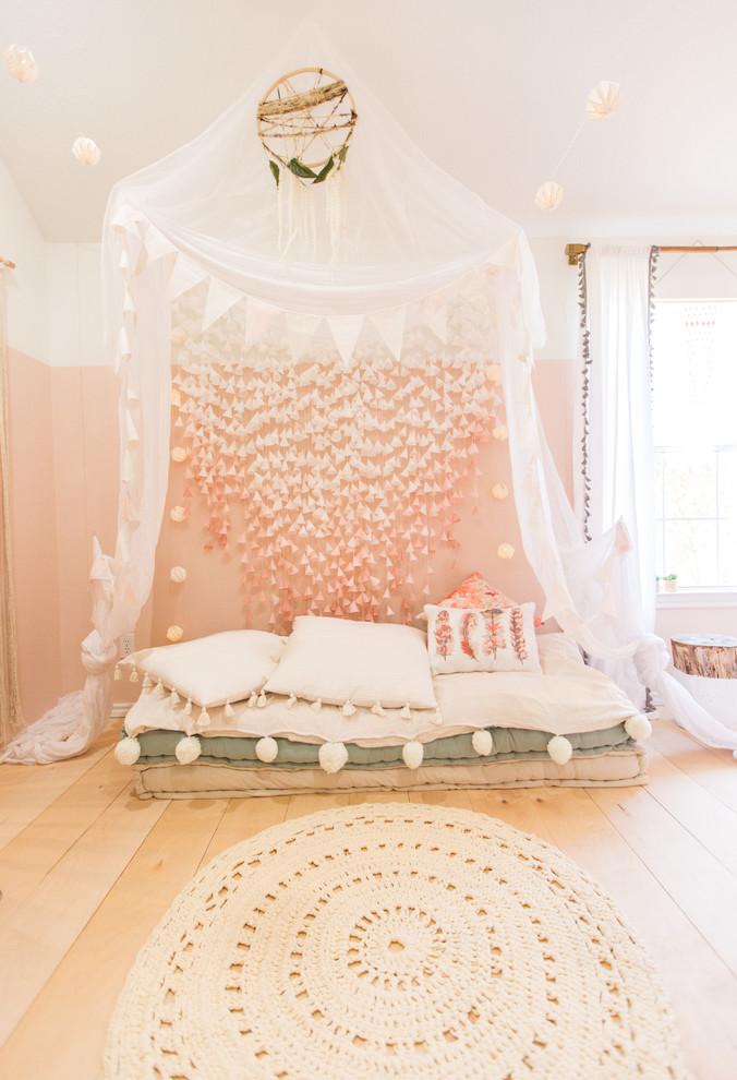 Kids' room - scandinavian girl light wood floor kids' room idea in Dallas with pink walls