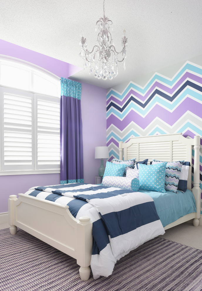 Example of a transitional girl kids' room design in Toronto with multicolored walls