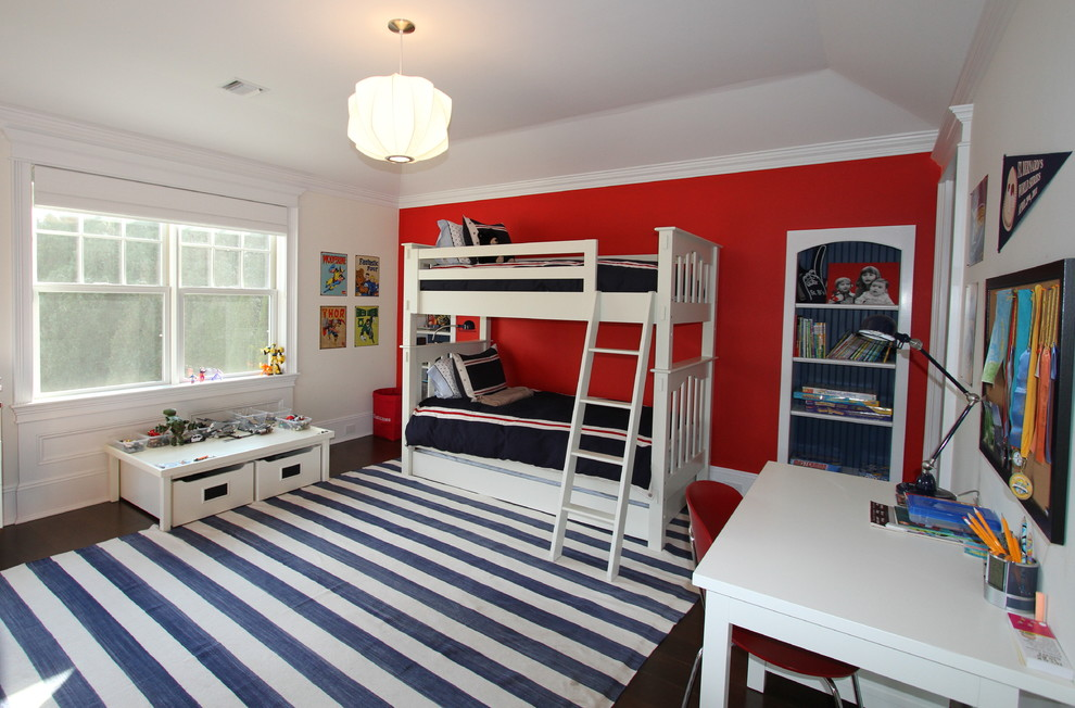 Large transitional boy dark wood floor and brown floor kids' room photo in New York with red walls
