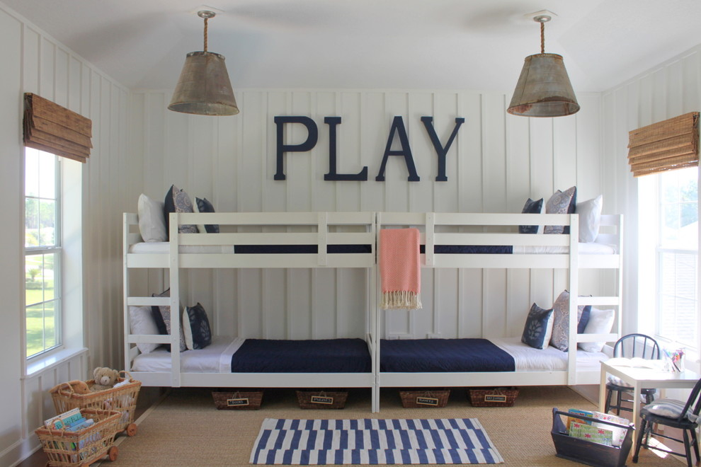 Example of a large beach style gender-neutral kids' room design in Jacksonville with white walls
