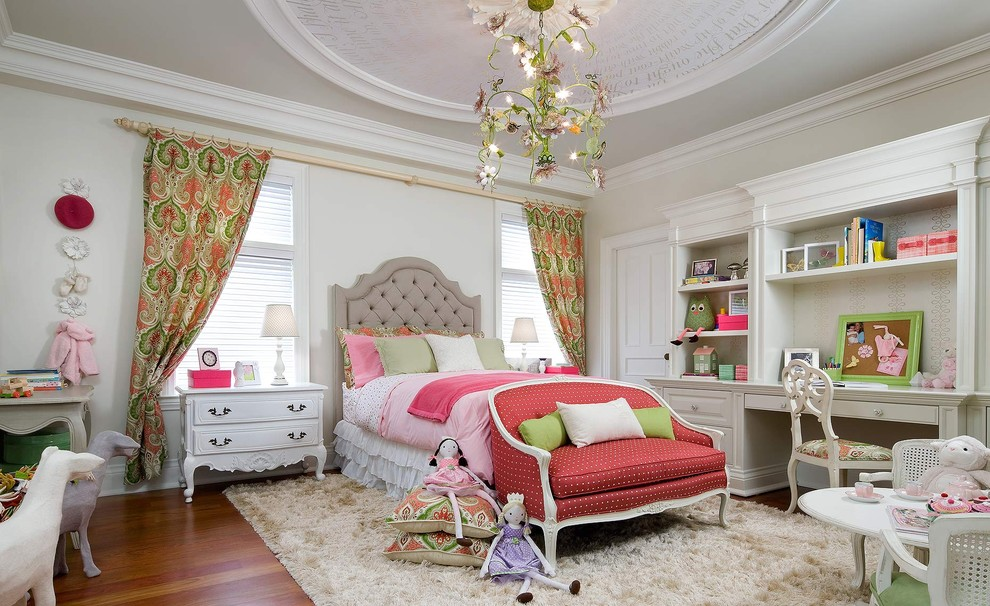 Kids' room - victorian girl medium tone wood floor kids' room idea in Toronto with beige walls