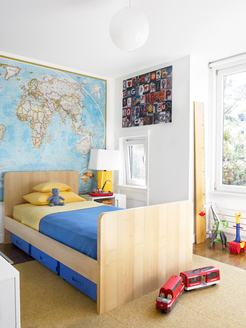 Example of a mid-sized minimalist boy medium tone wood floor and brown floor kids' room design in New York with white walls