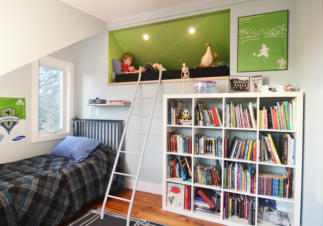 Inspiration for a medium sized contemporary teen's room for boys in Austin with blue walls and medium hardwood flooring.