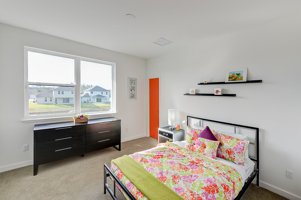 Kids' room - mid-sized modern girl carpeted kids' room idea in Jacksonville with white walls
