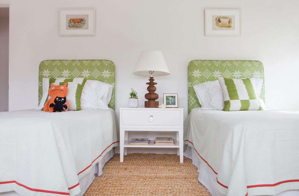 Elegant gender-neutral kids' room photo in Boston with white walls