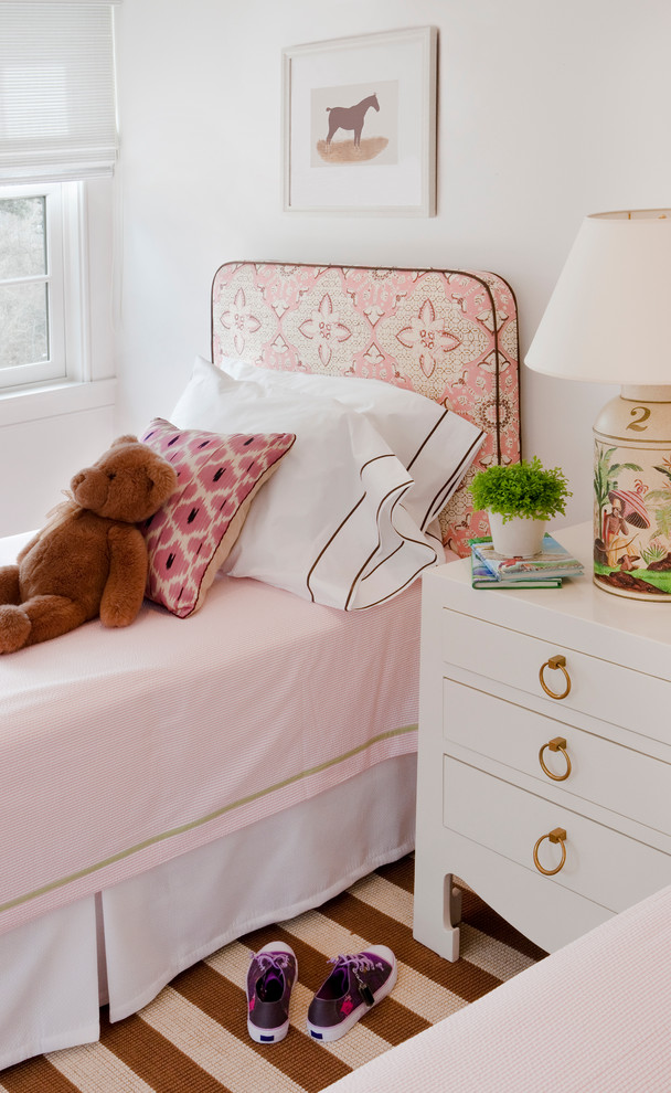 Example of a classic kids' room design in Boston with white walls