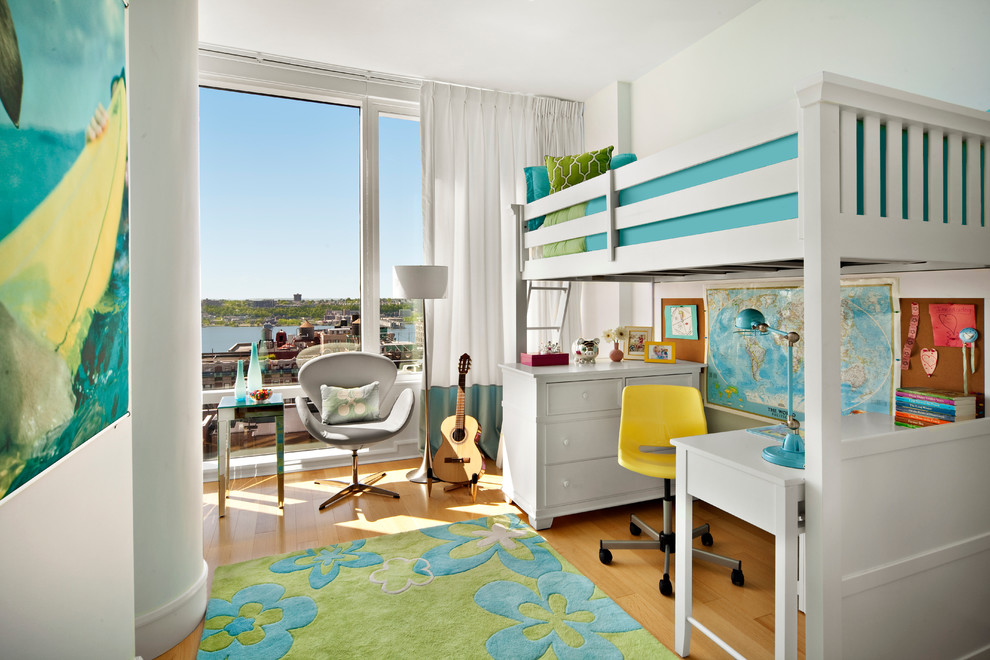 Kids' room - small transitional girl medium tone wood floor kids' room idea in Miami with white walls