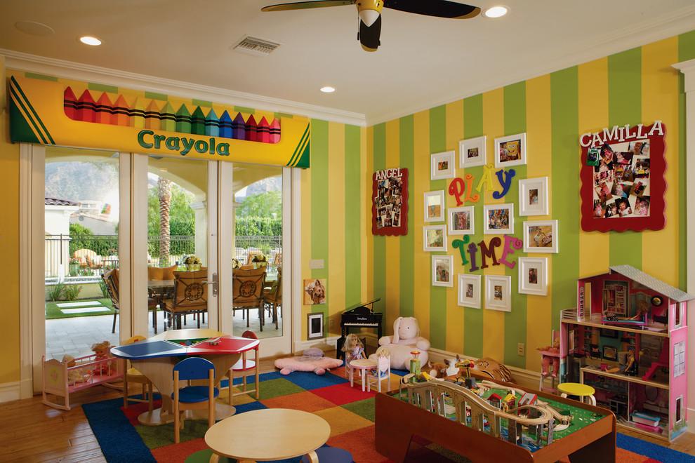 Huge transitional gender-neutral medium tone wood floor kids' room photo in Phoenix with multicolored walls