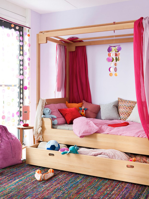 Inspiration for a contemporary girl kids' room remodel in Amsterdam with purple walls