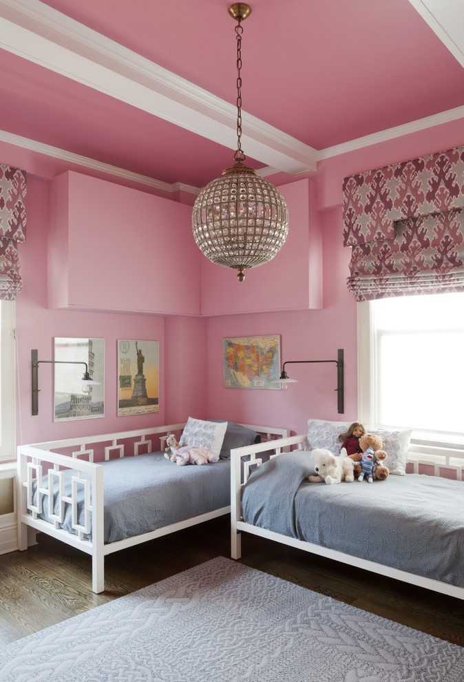 Example of a transitional kids' room design in New York with pink walls