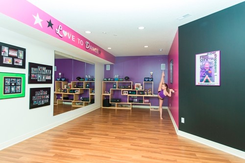 Great Way To Make A Long Narrow Room Look Bit Ger Love All The Various Lighting And Wall Shelves For Photos Trophies Flooring Is Fun Touch