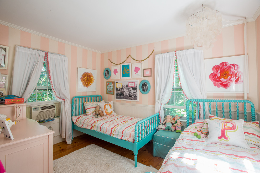 Example of a mid-sized classic girl medium tone wood floor kids' room design in Boston with multicolored walls