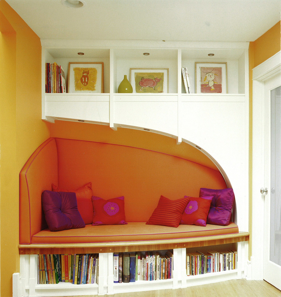 Inspiration for an eclectic kids' room remodel in Chicago with orange walls